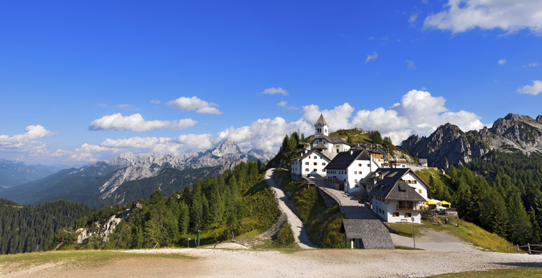 Panoramic view of the ancient village of Monte Lussari (1790 m) in the Italian Alps. Tarvisio, Friuli Venezia Giulia, Italy